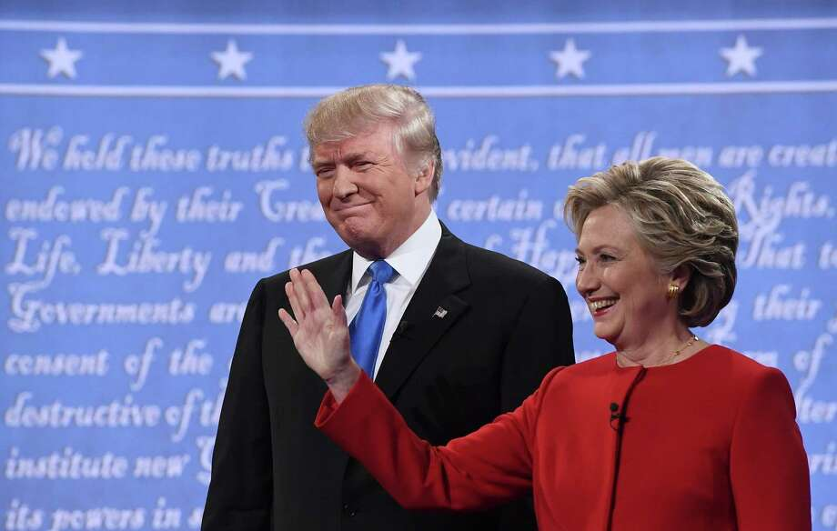 Democratic nominee Hillary Clinton (R) stands next to Republican nominee Donald Trump during the first presidential debate at Hofstra University in Hempstead, New York on September 26, 2016. / AFP PHOTO / Jewel SAMADJEWEL SAMAD/AFP/Getty Images Photo: JEWEL SAMAD / AFP or licensors