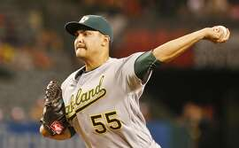 Oakland Athletics starting pitcher Sean Manaea works against the Los Angeles Angels in the first inning of baseball game Monday, Sept. 26, 2016, in Anaheim, Calif.  (AP Photo/Lenny Ignelzi)