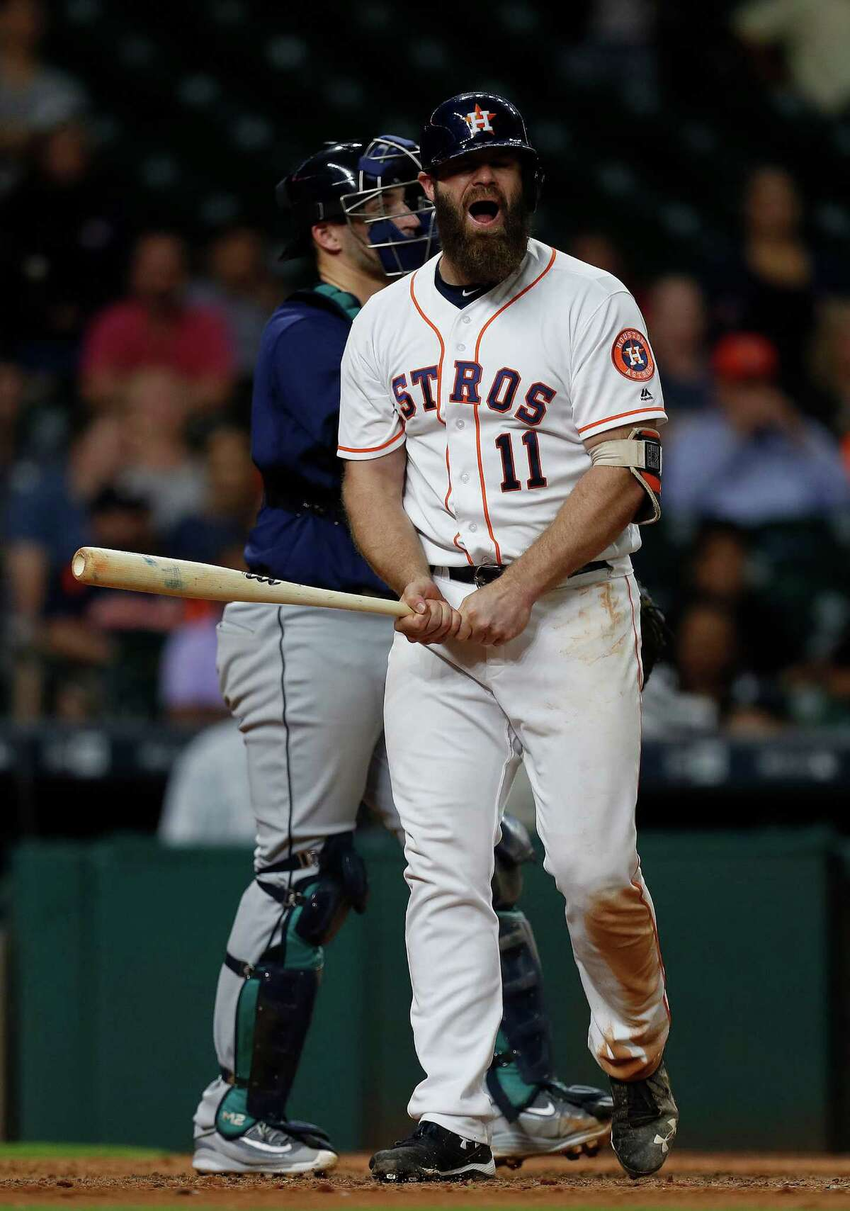 Houston Astros designated hitter Evan Gattis (11) reacts as he struck out with two runners on base in the eleventh inning of an MLB game at Minute Maid Park, Monday, Sept. 26, 2016 in Houston.