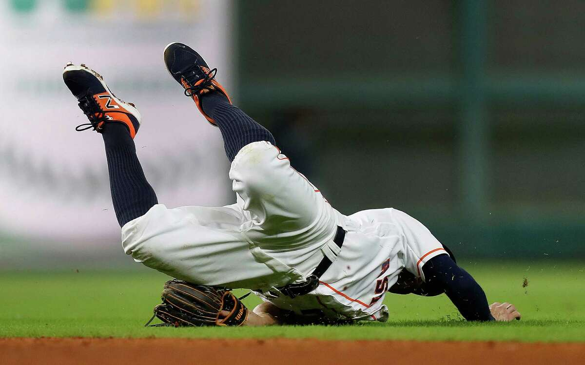Astros second baseman Jose Altuve appeared to hurt himself diving for a single by the Mariners' Kyle Seager in the sixth inning, but he shook it off and stayed in the game.