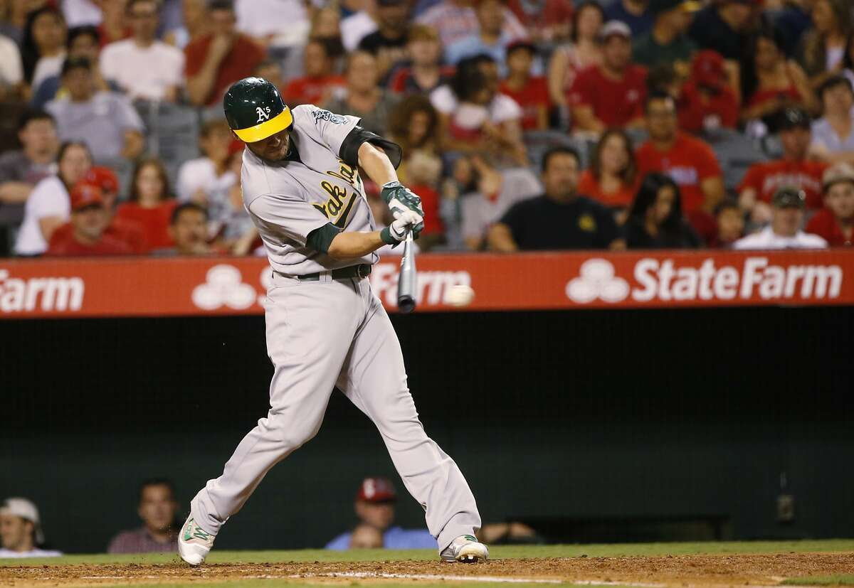 Oakland Athletics' Danny Valencia swings on a base hit off Los Angeles Angels' Jared Weaver during the fifth inning of baseball game Monday, Sept. 26, 2016, in Anaheim, Calif. (AP Photo/Lenny Ignelzi)
