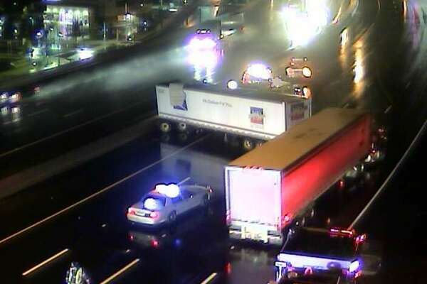 A tractor-trailer truck blocks two southbound lanes on I-95 in Bridgeport on Tuesday, Sept. 27, 2016.