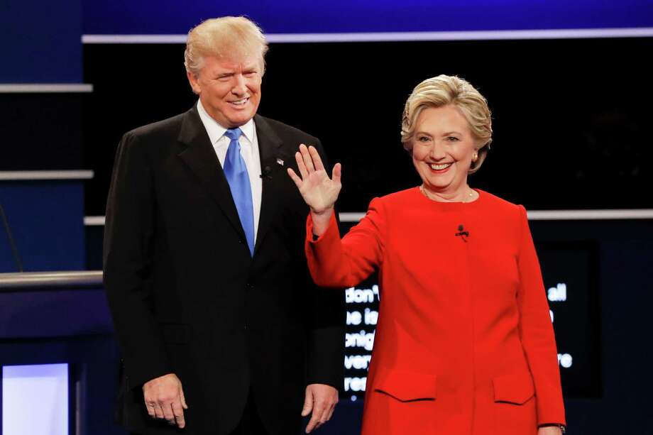 Republican presidential nominee Donald Trump and Democratic presidential nominee Hillary Clinton are introduced during the presidential debate at Hofstra University in Hempstead, N.Y., Monday, Sept. 26, 2016. (AP Photo/David Goldman) ORG XMIT: NYDB118 Photo: David Goldman / Copyright 2016 The Associated Press. All rights reserved.