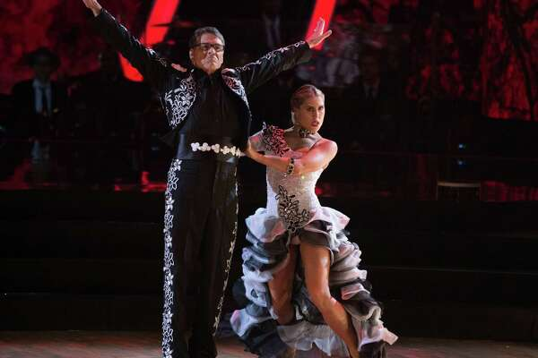 """Former governor of Texas, Rick Perry, dances the paso doble with partner Emma Slater during the live Sept. 26, 2016, broadcast of """"Dancing with the Stars"""" on ABC."""