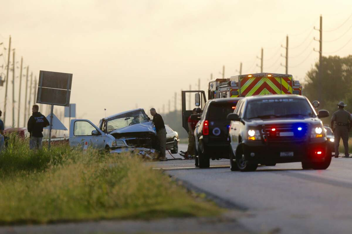 Police and emergency officials are seen on FM 1093 near Cross Creek Bend Lane in Fulshear, Texas. One person died following a vehicle wreck in the morning hours of Sept. 27, 2016.