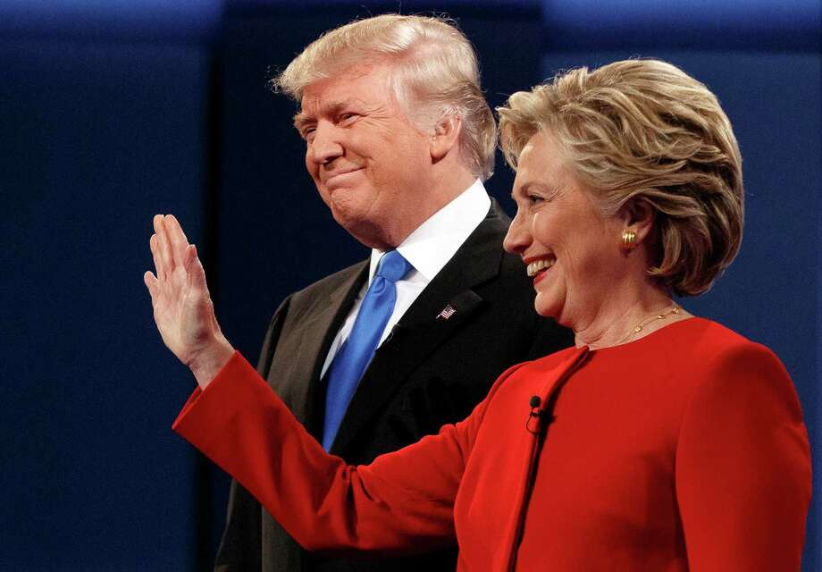 Republican presidential candidate Donald Trump stands with Democratic presidential candidate Hillary Clinton at the first presidential debate at Hofstra University, Monday in Hempstead, N.Y. Photo: Evan Vucci /Associated Press / Copyright 2016 The Associated Press. All rights reserved.