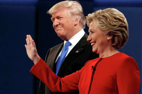 Republican presidential candidate Donald Trump stands with Democratic presidential candidate Hillary Clinton at the first presidential debate at Hofstra University, Monday in Hempstead, N.Y.