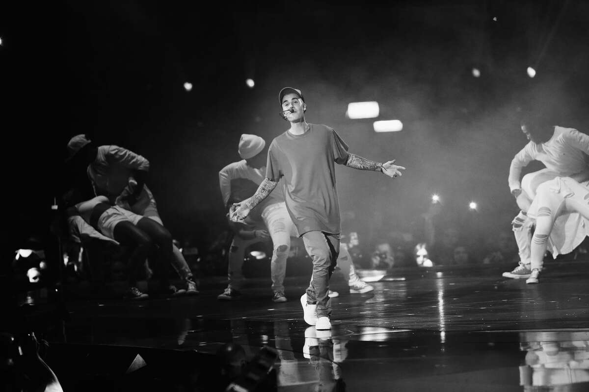 MILAN, ITALY - OCTOBER 25: (EXCLUSIVE COVERAGE) (EDITORS NOTE: Image has been converted to black and white) An alternative view of Justin Bieber as he performs on stage during the MTV EMA's 2015 at the Mediolanum Forum on October 25, 2015 in Milan, Italy. (Photo by Vittorio Zunino Celotto/MTV 2015/Getty Images for MTV)
