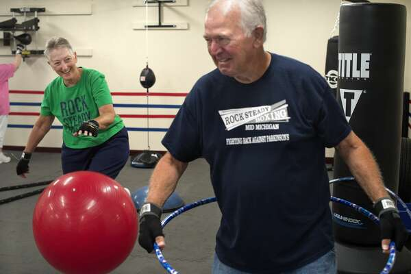 Joan Billingsley, left, and her husband Tom Billingsley, both of Sanford, go through a round of exercises at the Rock Steady Boxing gym in Midland July 11. The Billingsley's met at Central Intermediate  in 1956 when Tom cut the school's lunch line in order to meet Joan; they were married in March 1, 1970.