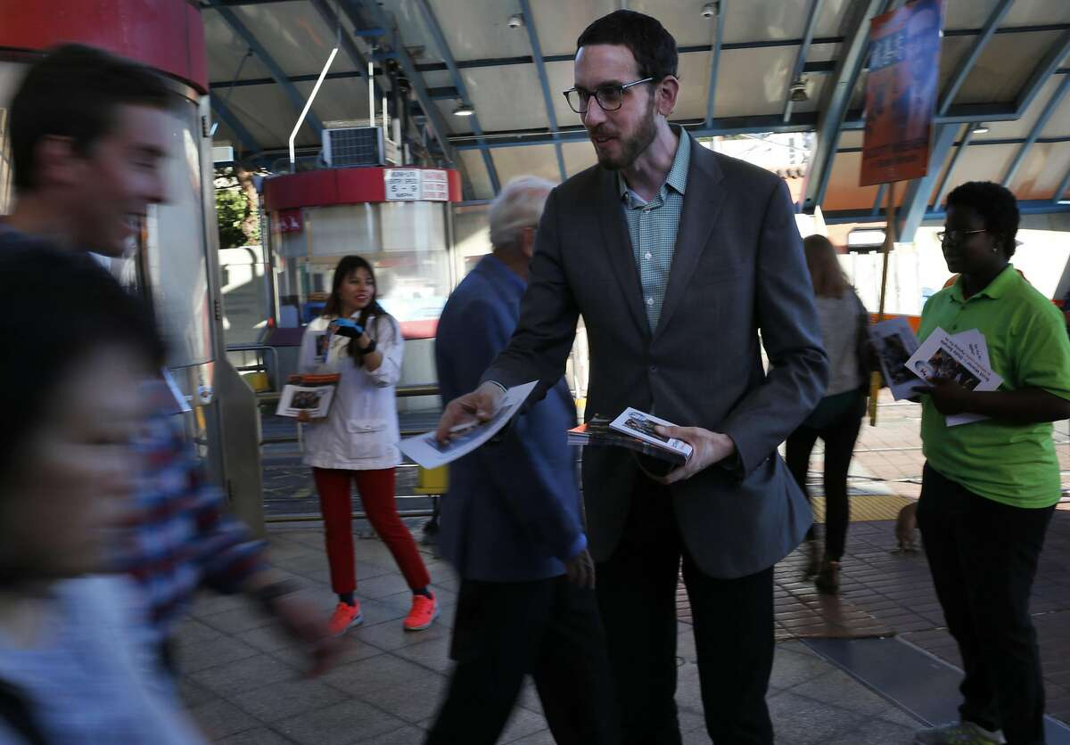 Supervisor Scott Wiener attempts to hand out fliers while campaigning at the West Portal Muni stop Sept. 23, 2016 in San Francisco, Calif.