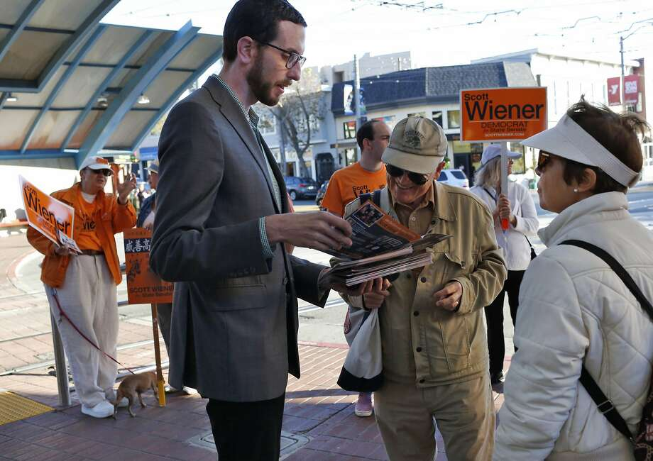 Roger Ritter, President of West of Twin Peaks Central Council, center, talks to Supervisor Scott Wiener about crime and public safety concerns as Mary Ritter, Roger's wife, listens at right, while Wiener campaigs at the West Portal Muni stop Sept. 23, 2016 in San Francisco, Calif. Photo: Leah Millis, The Chronicle