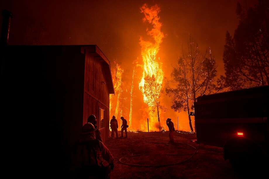 Firefighters work to save a fire station on Loma Chiquita Road as flames from the Loma fire approach on Monday, Sept. 26, 2016, near Morgan Hill, Calif. Photo: Noah Berger, Special To The Chronicle