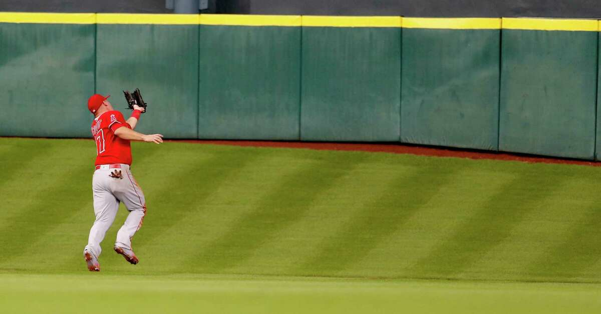 Los Angeles Angels center fielder Mike Trout (27) catches Houston Astros Jose Altuve's fly out on Tal's Hill during the first inning of an MLB baseball game at Minute Maid Park, Tuesday, June 21, 2016, in Houston. ( Karen Warren / Houston Chronicle )