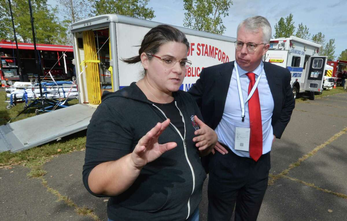 The City of Norwalk Deputy Director of Emergency Management Michele DeLuca talks with Easton First Selectman Adam Dunsby during the Region 1 Emergency Planning Team Preparedness and Response Field Day on Monday at Sherwood island State Park in Westport.