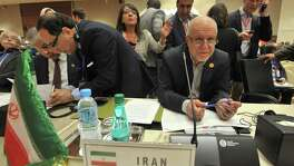 Iran's Oil Minister Bijan Namdar Zanganeh (center right) attends the opening session of the 15th International Energy Forum Ministerial meeting Tuesday in Algiers, Algeria. At meetings in Algeria this week, energy ministers from OPEC and other oil-producing countries are discussing whether to freeze production levels to boost global oil prices.