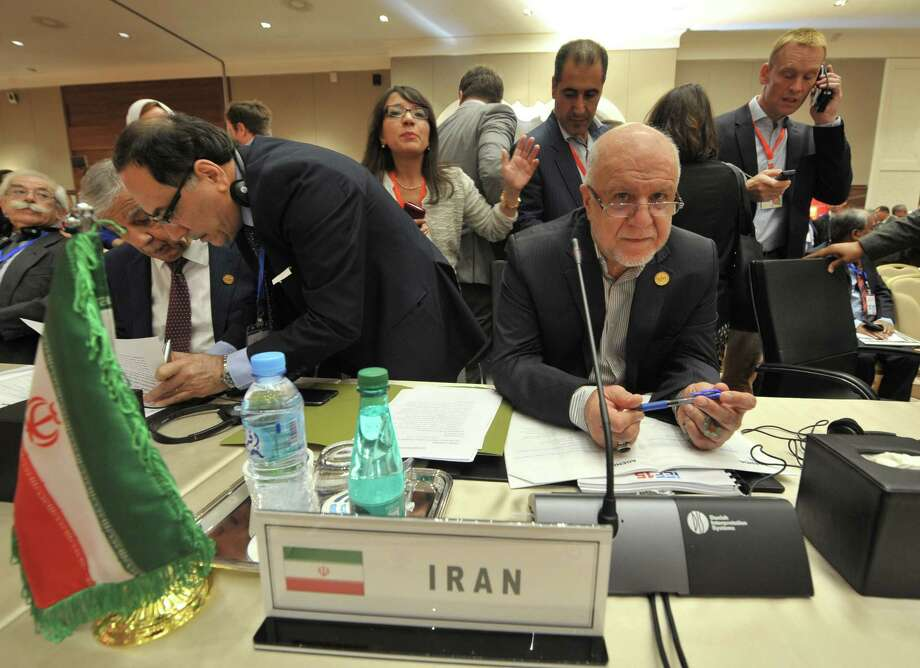 """Iran's Oil Minister Bijan Namdar Zanganeh (center right) attends the opening session of the 15th International Energy Forum Ministerial meeting Tuesday in Algiers, Algeria. """"It's not our agenda to reach agreement in these two days,"""" he said, adding that he was in Algiers """"to have a consultative informal meeting with OPEC to exchange views, not more."""" Photo: Sidali Djarboub /Associated Press / AP"""