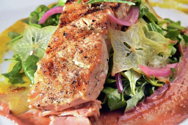 Wild caught salmon salad at the City Beer Hall at the corner of Howard & Lodge Streets Wednesday Sept. 21, 2016 in Albany, NY.  (John Carl D'Annibale / Times Union)