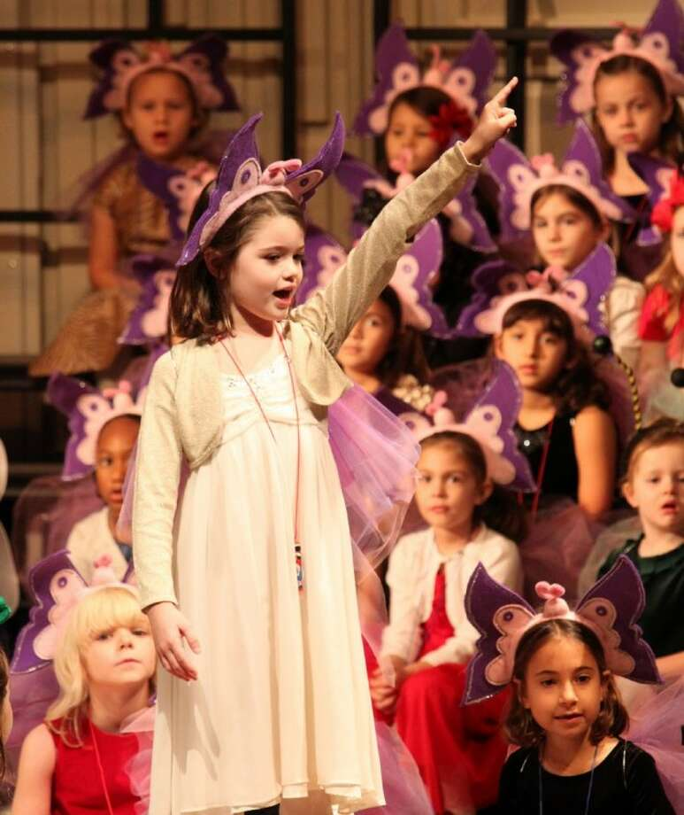 """Duchesne Academy first-grader Mia Dowler sings """"Will You Go"""" during the Lower School presentation of the annual Pre-K, Kindergarten and first grade Christmas pageant. This year's production, Angels, Lambs, Ladybugs, and Fireflies, was attended by an enthusiastic audience of parents and family members."""