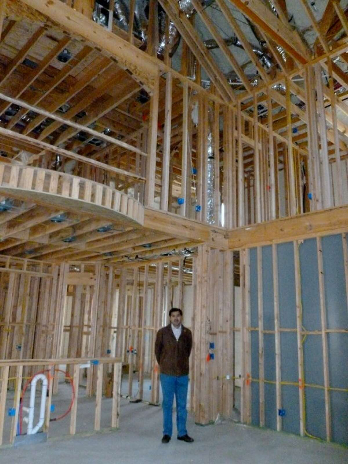 Graduate master builder N. Harris Malik, owner of Sunrise Custom Homes, oversees construction at one of his homes.