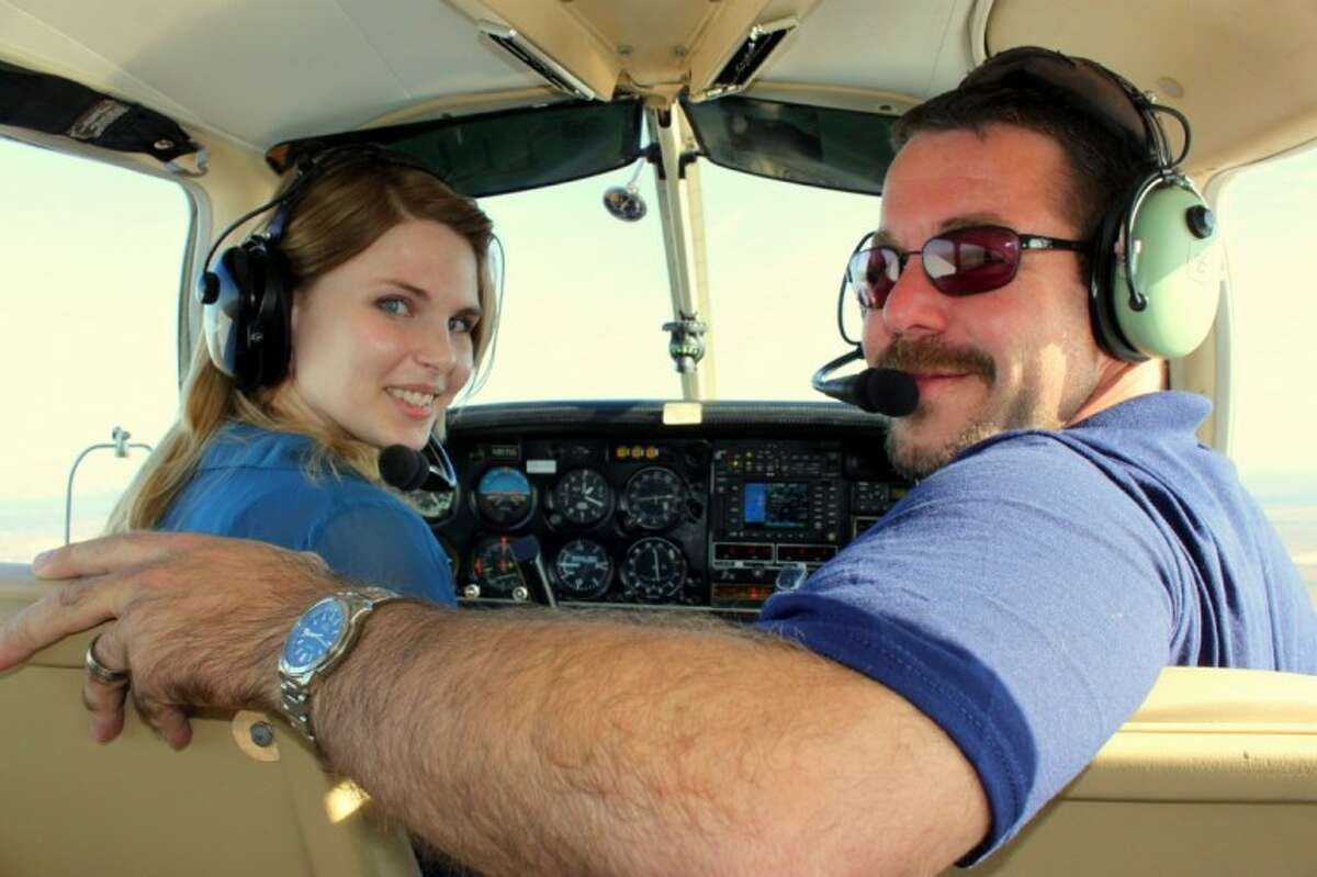 Flight instructor Aaron Stinson takes passengers on a ride over Cypress.