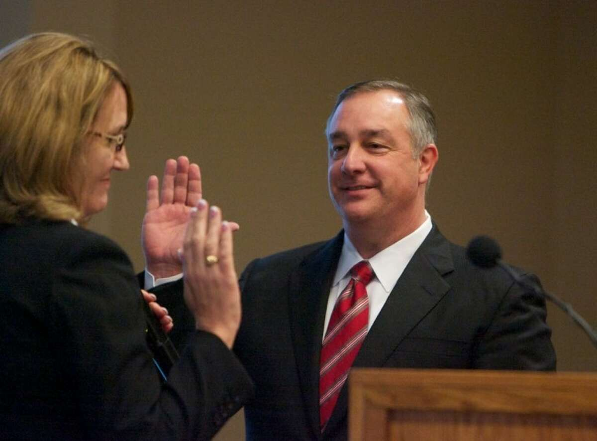 Kelly Case is sworn in by Judge Lisa Michalk as the new 9th Judicial District Judge during Tuesday morning's ceremony at the Lone Star Convention Center in Conroe.