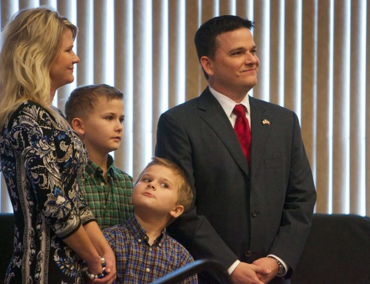 James Noack smiles as he stands with his family before taking the Oath of Office during Tuesday morning's ceremony.