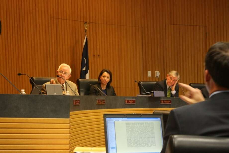 A candid picture from a Pearland City Council meeting held in June 2011. Pictured from left: Mayor Tom Reid, Councilmember Felicia Harris and Ed Thompson. Photo: KRISTI NIX