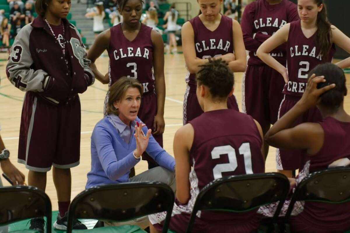 Clear Creek girls' head basketball coach Jana Williams tries to energize her squad during its game with Clear Falls Wednesday afternoon. The Lady Knights defeated Creek, 69-34.