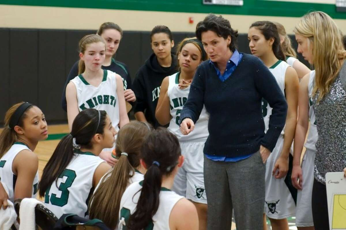 Clear Falls girls' head basketball coach Shannon Osborne talks to her team during its District 24-5A game with Clear Creek Wednesday afternoon.