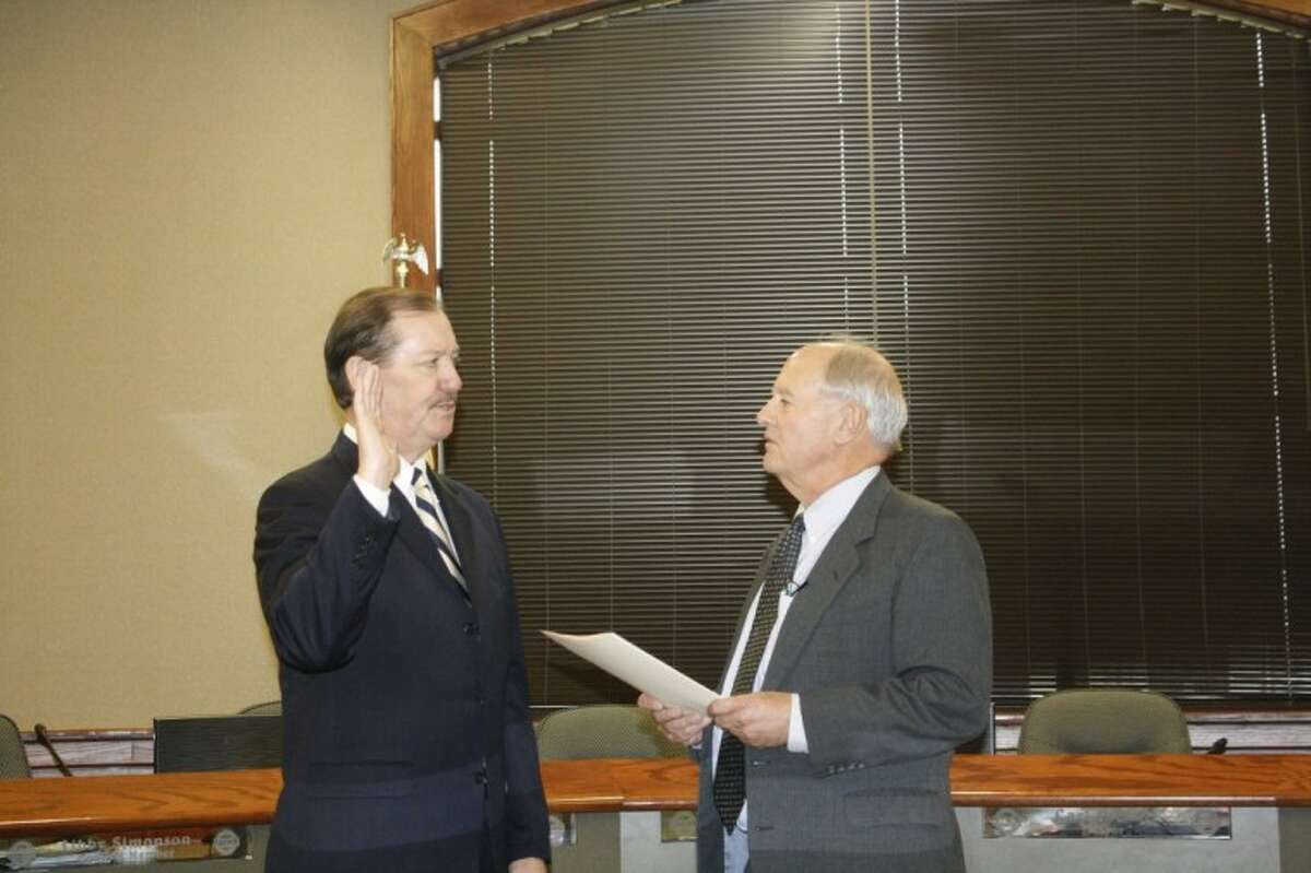 Incoming Liberty Municipal Court Judge Mike Little receives the oath of office from Liberty Mayor Carl Pickett. Little was chosen to replace outgoing Judge Bobby Rader who was elected as Liberty County Sheriff.