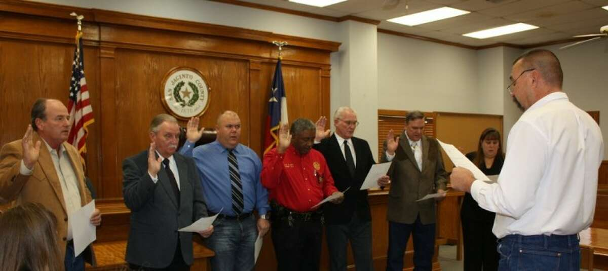 San Jacinto County Judge Fritz Faulkner, right, swore in seven county officials as they took office on Jan. 1, 2013. Shown from left to right are Pct. 3 Constable Sam Houston, Pct. 1 Constable Roy Rogers, Pct. 2 Constable Roy Pippin Jr., Pct. 4 Constable Alvin Wyatt, Pct. 3 Commissioner Thomas Bonds, Pct. 1 Commissioner Ray McCoppin and Tax Assessor-Collector Kelly Selmer.
