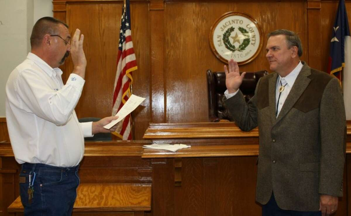 Ray McCoppin, right, was sworn in on Jan. 1 as the new county commissioner for Pct. 1. County Judge Fritz Faulkner, left, administered the oath of office.
