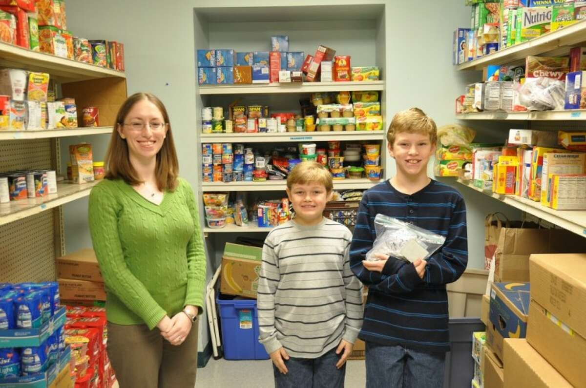 (Pictured from left to right: Stephanie Hodges, CCSC Emergency Services Manager, Caleb Bowen and Jacob Bowen holding his donation.