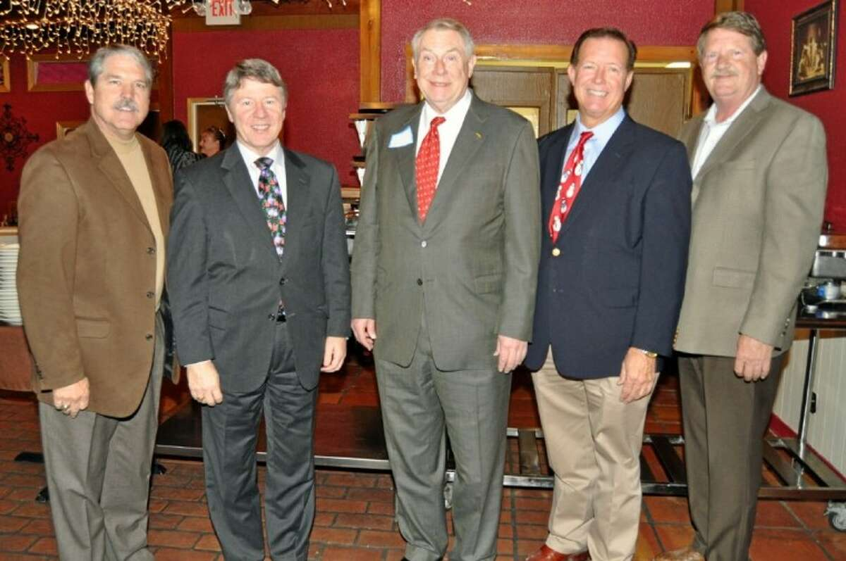 Enjoying the holiday festivities at the SJRW holiday event at Ernie's are pictured from left, State Senator-elect Larry Taylor, County Judge Ed Emmett, State Representative Wayne Smith, Congressman-elect Randy Weber and Senator Mike Jackson.
