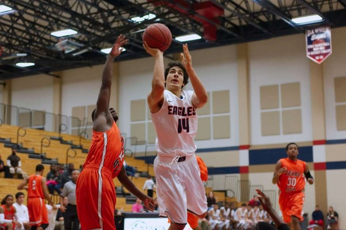 Dawson's Ivan Medina puts up a shot against Texas City Wednesday in a District 24-4A boys' basketball opener. Dawson won the game, 57-56.