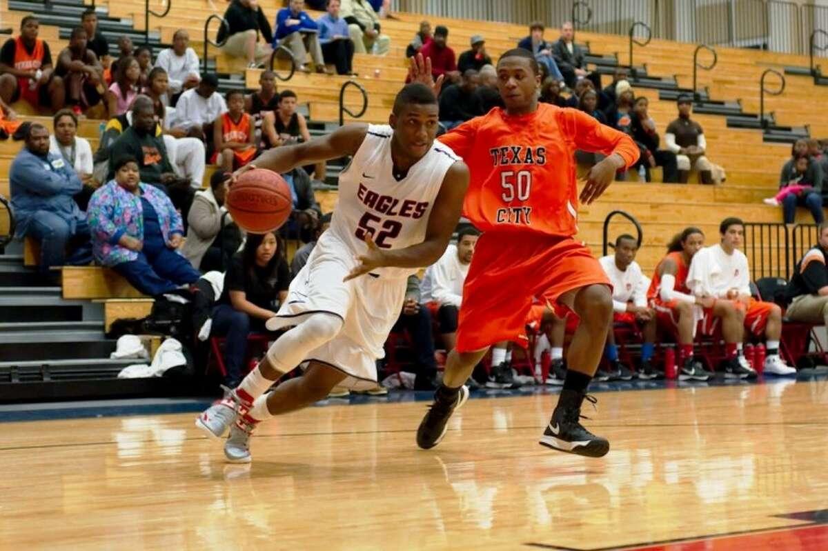 Dawson's Tony Upchurch drives to the basket past Texas City's Anthony Johnson. Dawson defeated the Stingarees, 57-56.