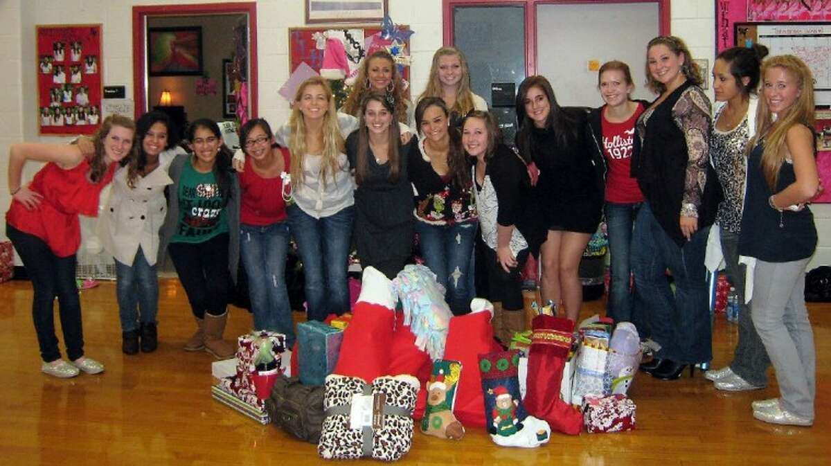 Members of the Austin Angels Dance Team with donated items.