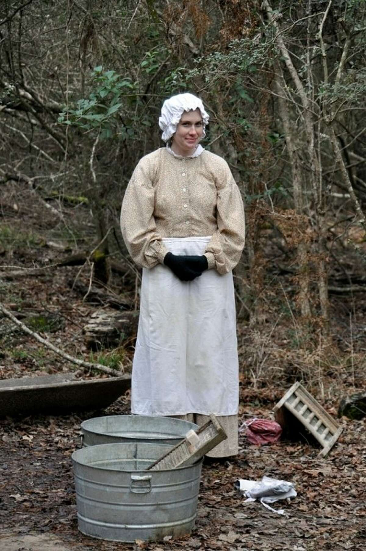 Jones Park Volunteer Brittany Ann Brownlow demonstrates how clothes were washed during Homestead Heritage Day 2010.