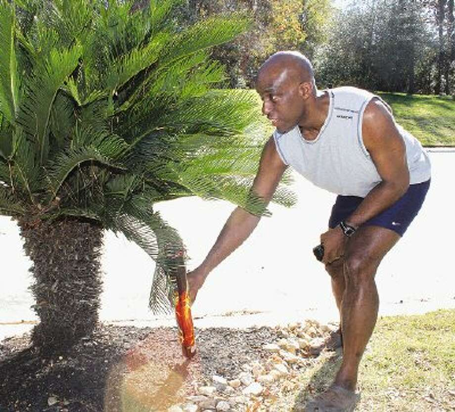 Kingwood resident Egberto Willies shows where someone tried to place a Fire Hawk firework, a 140-shot roman candle, in his yard on Jan 1. around 11 p.m. The person attempted to place the firework in another bush and successfully ignited the explosive toward Egberto's house, causing minor soot damage to the entryway and leaving a squirrel dead on the walkway.