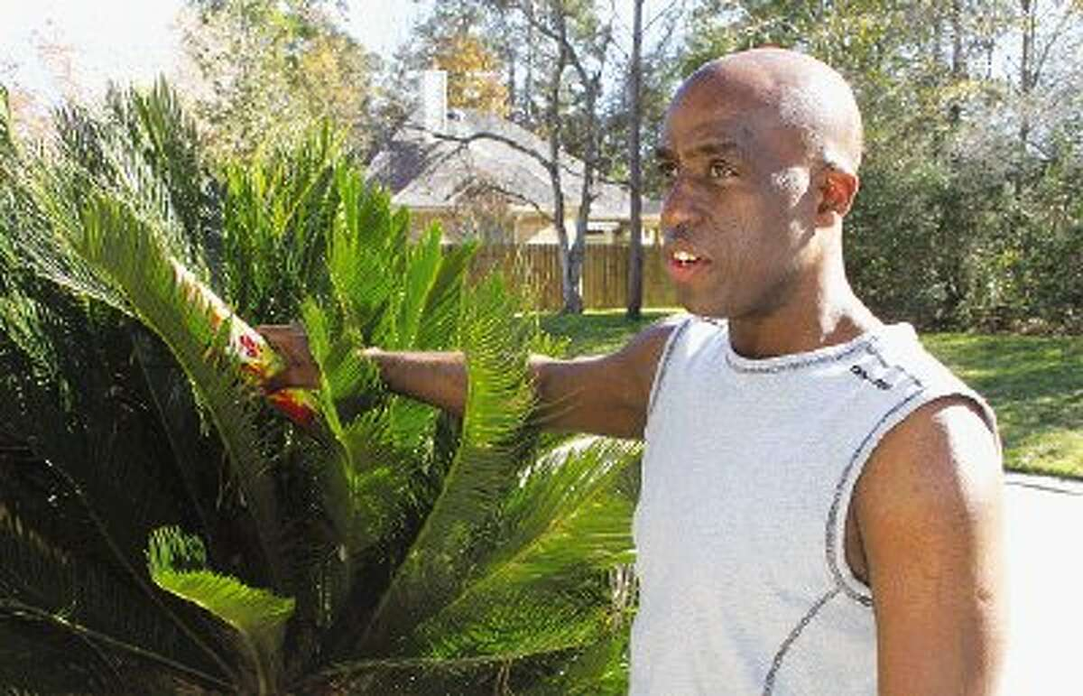 Kingwood resident Willies Egberto shows where someone placed a Fire Hawk firework, a 140-shot roman candle, in his yard on Jan 1. around 11 p.m. The explosive caused minor soot damage to the house and killed a squirrel in a nearby tree.