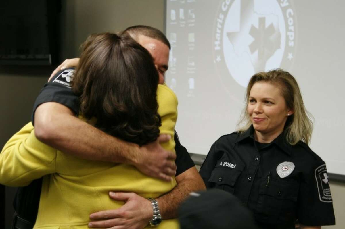 Rita Jolivet receives a hug from ESD 1 Paramedic Alier Romero as fellow paramedic Amy Spoerle looks on. Jolivet recently was reunited with the emergency crews who saved her live after her son called 9-1-1 when she was suffering a heart attack about two weeks ago.