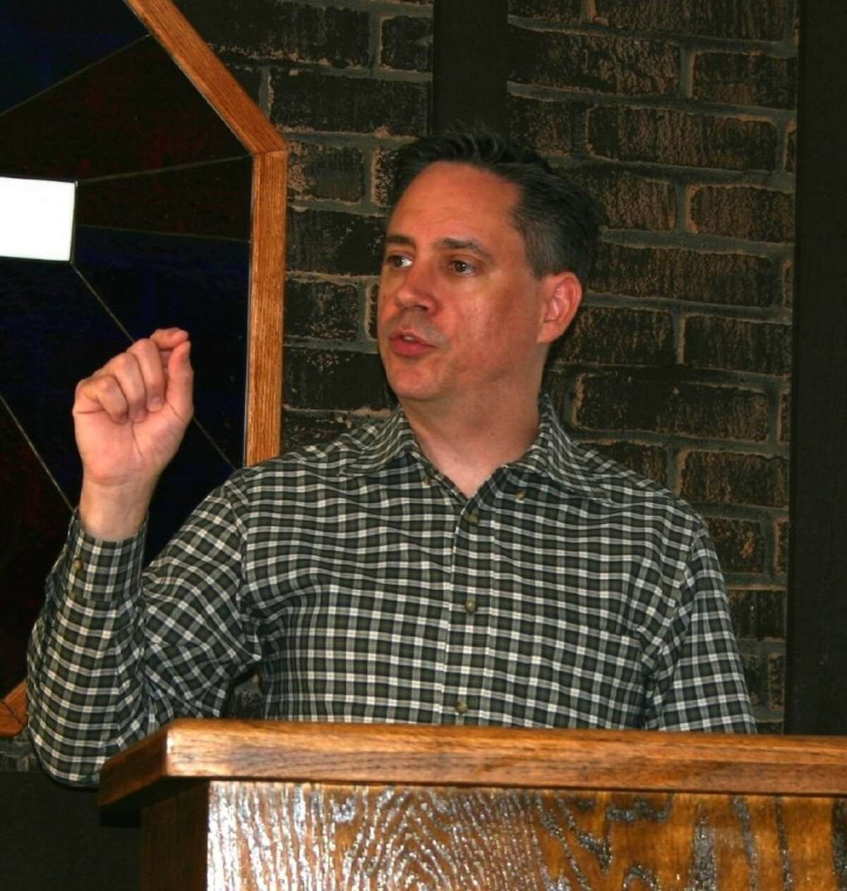 The Rev. Bryan Brunson, the pastor of Huffman's Covenant Baptist Church, delivers a New Year's Day sermon about the elements of authentic faith.