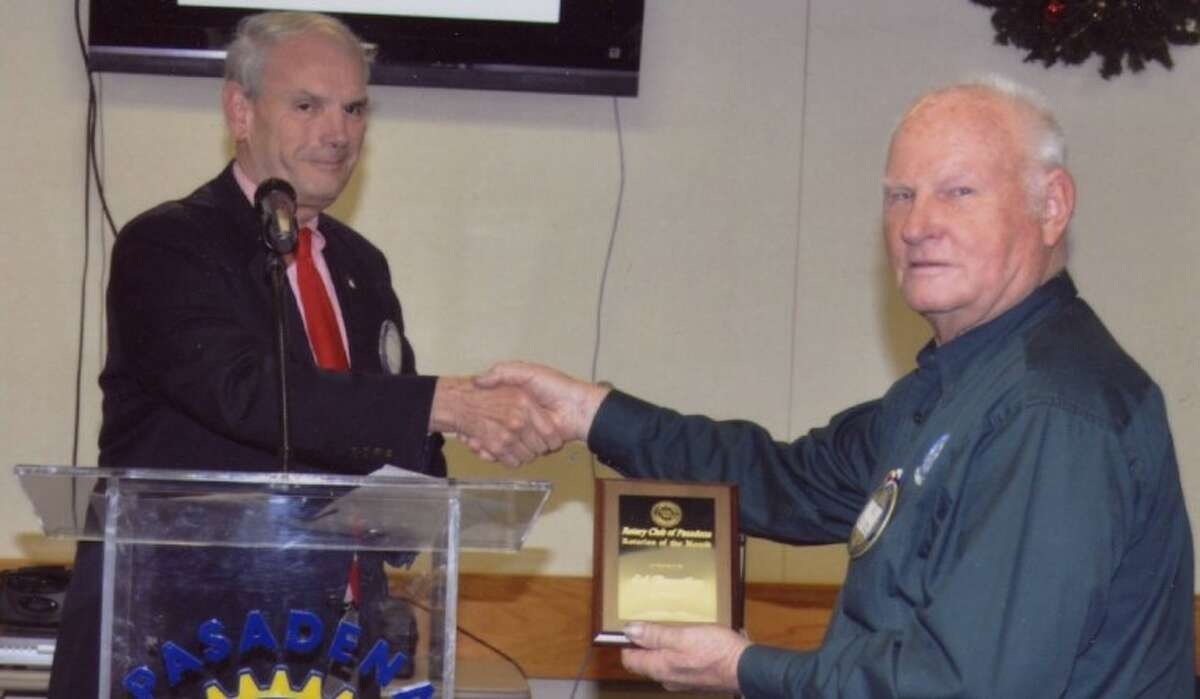 Lee Clark presents an award to Ed Brantley, the Rotarian of the Month for December.