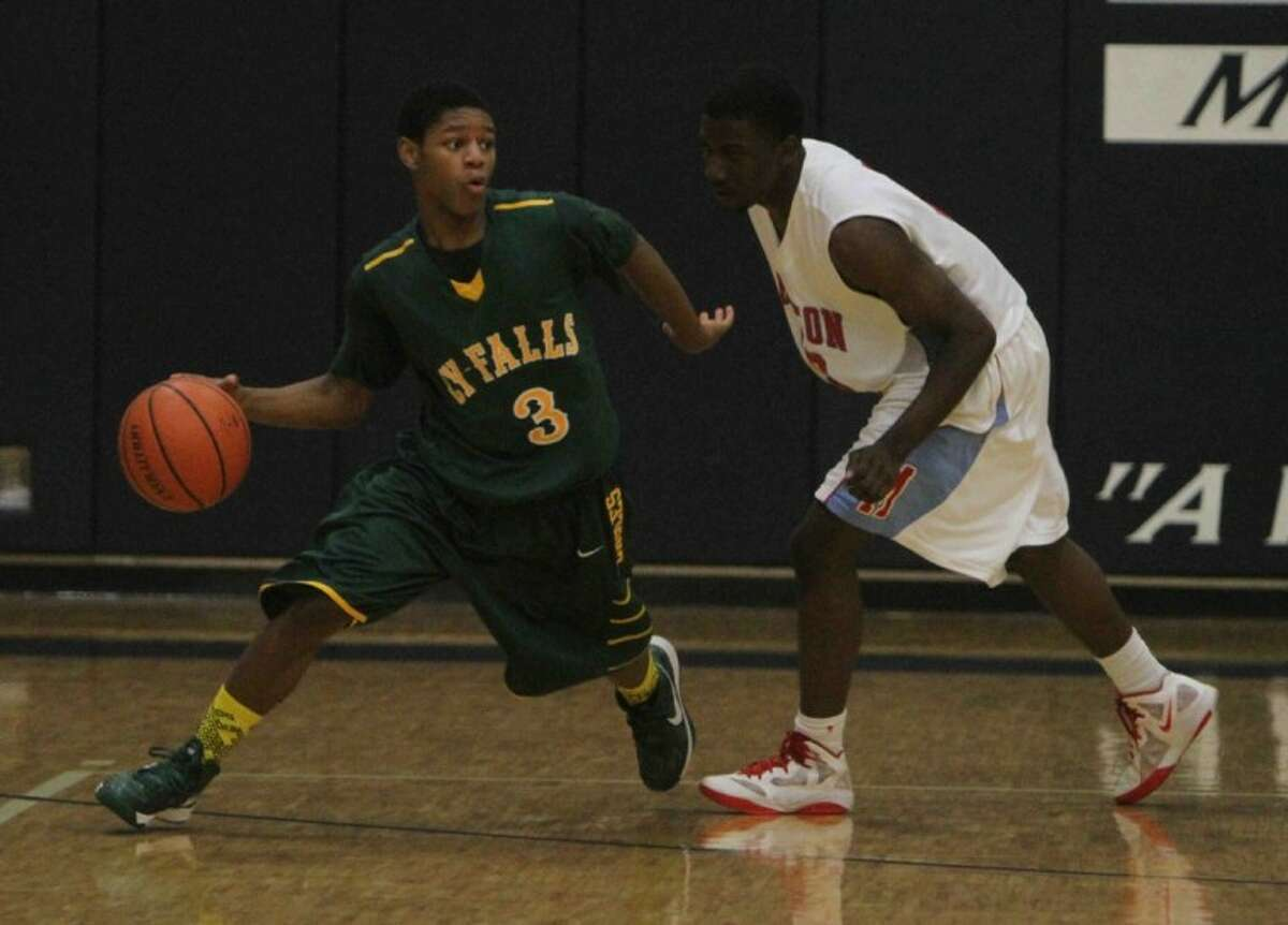Cy Falls guard Jalen Smith (3) brings the ball up during the opening round of the Insperity Kingwood Holiday Classic on Dec. 27. Cy Falls defeated Houston Madison, 83-38.