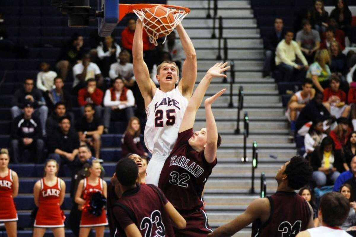 Clear Lake's Colton Krenek throws down a dunk in the Falcons' 62-54 win over Pearland Tuesday night in a District 24-5A basketball game at Krueger Fieldhouse.