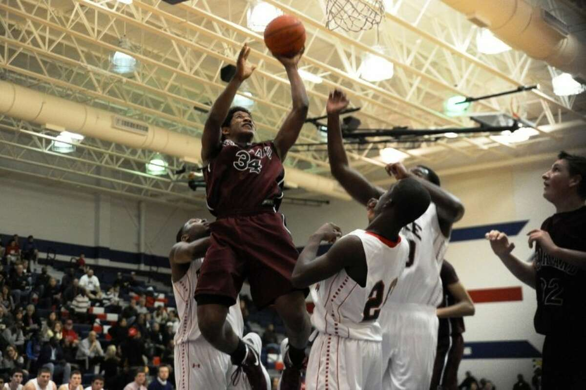 Pearland's Cameron Juniel goes up for a basket in the first half of the Oilers' 62-54 loss to Clear Lake Tuesday night at Krueger Fieldhouse.