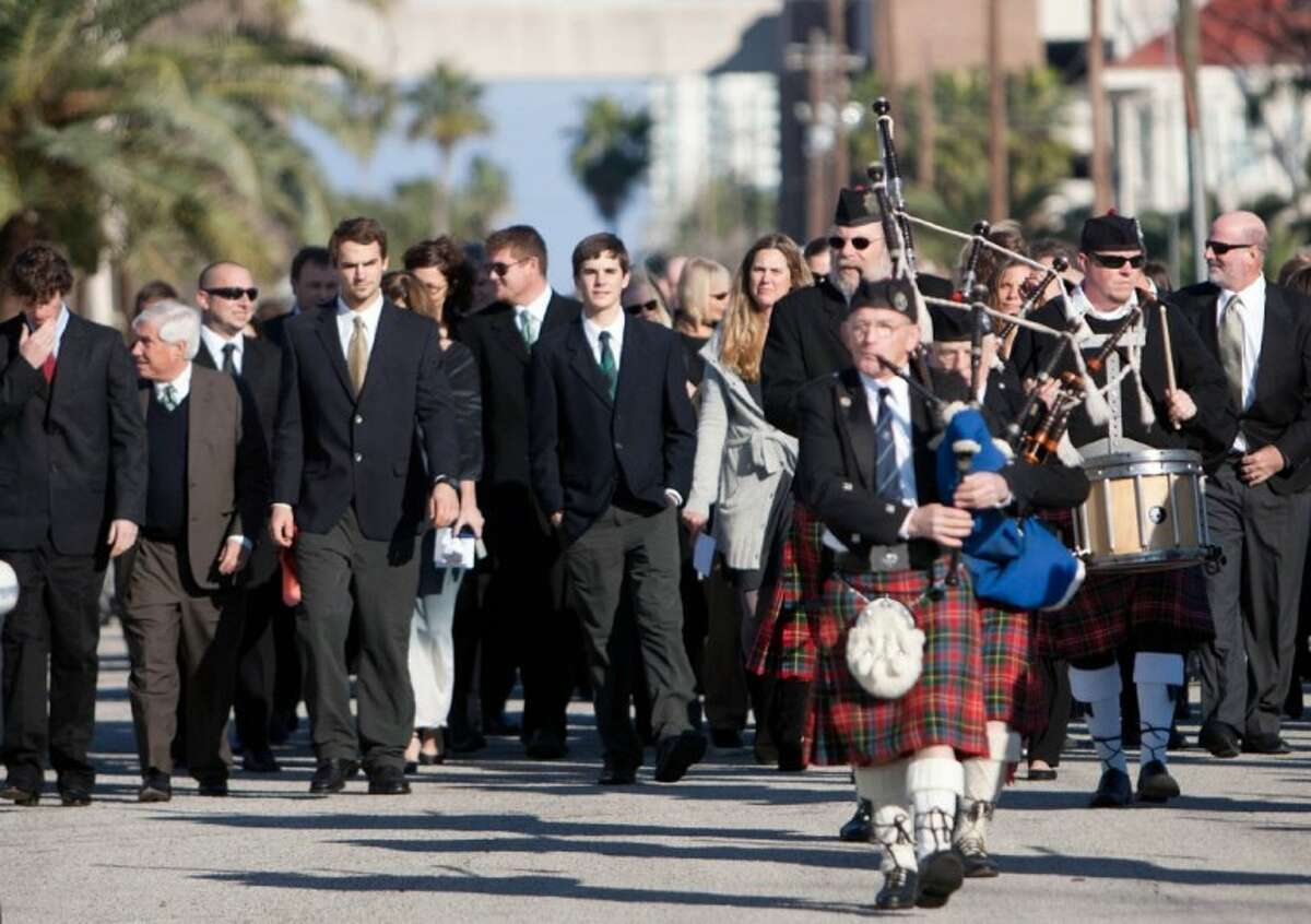 Hundreds of friends and family members took part in a funeral procession for Cynthia Woods Mitchell from the site of her memorial service at Trinity Episcopal Church to the Tremont Hotel in Galveston on Jan. 4, 2010.