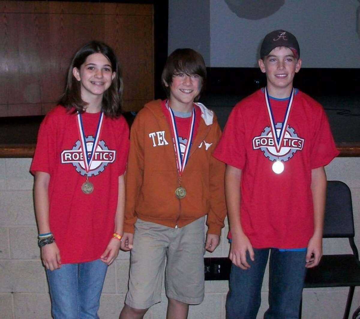 In District Robotics competition Dec. 4, Deer Park Junior High School's team of McKensie Robinson, Sammy Pennington, and Luke Wilson, won first place in the Arena competition. The team's sponsors are Leisa Davidson and Kay Guerrero.
