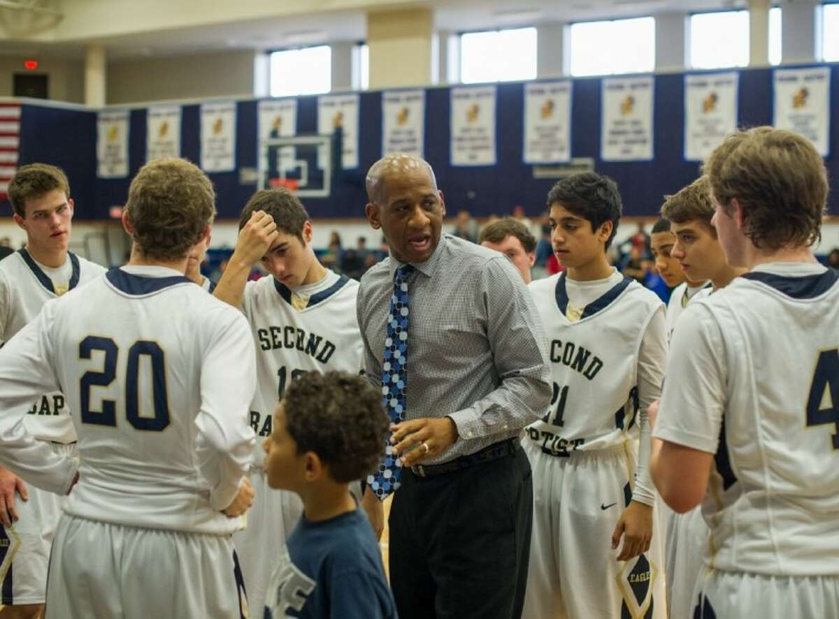 Second Baptist head basketball coach Kevin Mouton talks with his team between periods during a recent Eagle victory. Mouton and the Eagles are looking for a return trip to the TAPPS 4A state tournament, but first he said his team must navigate its way through a tough upcoming Division II 4A district schedule, which begins Tuesday, Jan. 8.