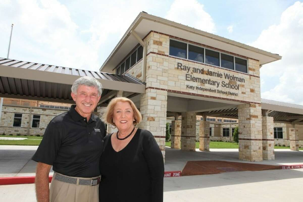 Ray and Jamie Wolman outside of the Elementary School named in their honor in Katy.